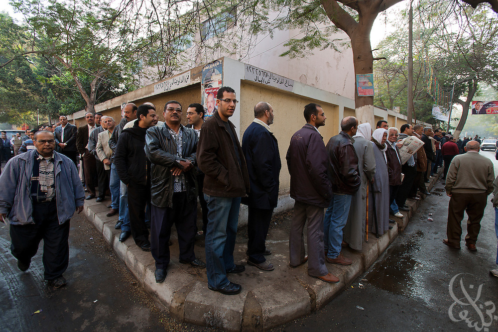 Egyptian voters cue in a line as they wait to take part in a historic free parliamentary election Nov 28, 2011 at a polling station in the Shubra district of the capital, Cairo. The first round of voting (1 of three) for the election, the first since the revolution in Egypt that ousted former president Hosni Mubarak earlier in the year, saw very high voter turnout and is hoped to be a positive step in the direction of a new democratic spirit for the country. (Photo by Scott Nelson)