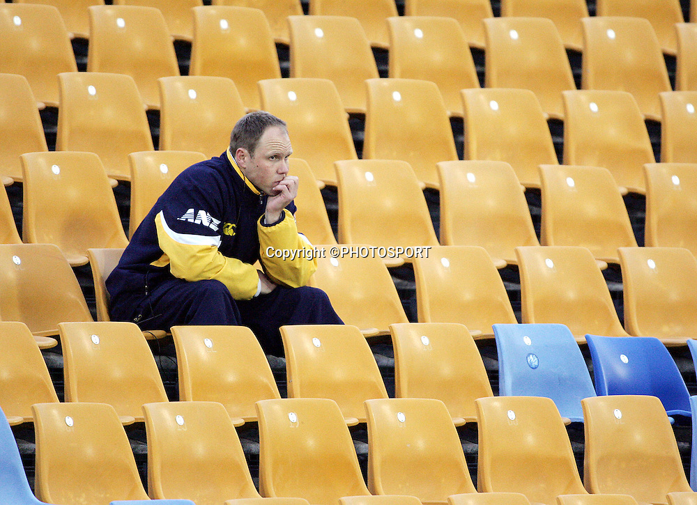 Former All Black Jeff Wilson watches the Otago team from the stands during the round one Air NZ Cup rugby union match between Counties Manukau and Otago at Mt Smart Stadium, Auckland, on Saturday 29 July 2006. Photo: Andrew Cornaga/PHOTOSPORT<br />