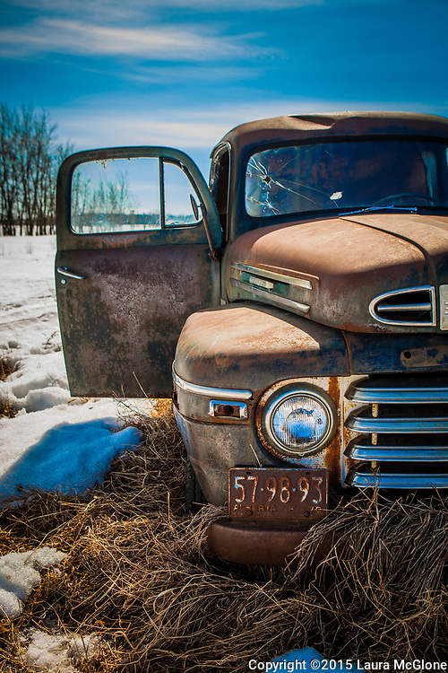 Vintage 1950s Mercury Truck on Prairie with Bullethole through windshield, door open, Alberta Canada
