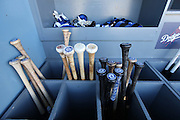 LOS ANGELES, CA - JUNE 17:  Bats and batting gloves are stored in dugout bins during batting practice before the Los Angeles Dodgers game against the Colorado Rockies at Dodger Stadium on Tuesday, June 17, 2014 in Los Angeles, California. The Dodgers won the game 4-2. (Photo by Paul Spinelli/MLB Photos via Getty Images)