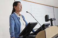 Female teacher in lecture theatre