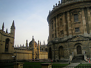 One of the colleges in Oxford University, with the sun creeping around the side of the building.