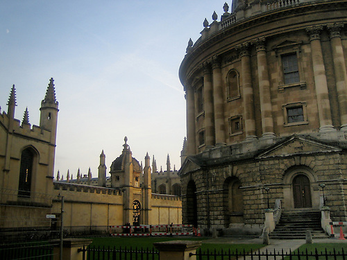 One Of The Colleges In Oxford University, With The Sun Creeping Around The  Side Of.