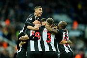 Miguel Almiron (#24) of Newcastle United leaps on top of his Newcastle United teammates in celebration of Paul Dummett (#3) of Newcastle United scoring Newcastle United's second goal (2-1) during the Premier League match between Newcastle United and Bournemouth at St. James's Park, Newcastle, England on 9 November 2019.