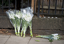 © Licensed to London News Pictures. 12/07/2020. London, UK. Flowers left at the scene of a murder on the Black Prince Estate in Kennington South London, just a few hundred years from the House of Parliament,  in which a man, believed to be in his 30s, was stabbed to death late last night . Photo credit: Ben Cawthra/LNP