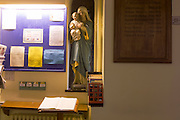 Noticeboard with Mary and Jesus figures at St. Lawrence's Catholic church in Feltham, London.