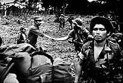 A campesino bids contra troops farewell as they leave their jungle base camp enroute to Nicaragua.