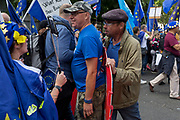 On the day that rebel Conservative Party rebels and opposition MPs attempt to pass a law designed to prevent a no-deal Brexit by the government of Prime Minister Boris Johnson, a Brexiteer tries to disrupt a march by pro-EU Remainers outside Parliament, on 3rd September 2019, in Westminster, London, England.
