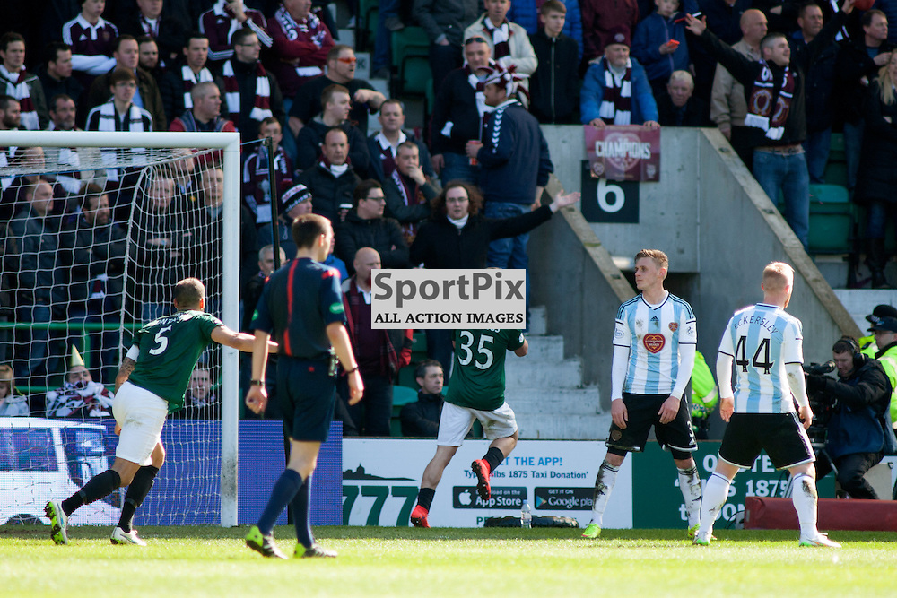 Jason Cummings celebrates in front of the Hearts fans in the Hibernian v Heart of Midlothian SPFL Championship at Easter Road Stadium, Edinburgh. 12 April 2015.<br />