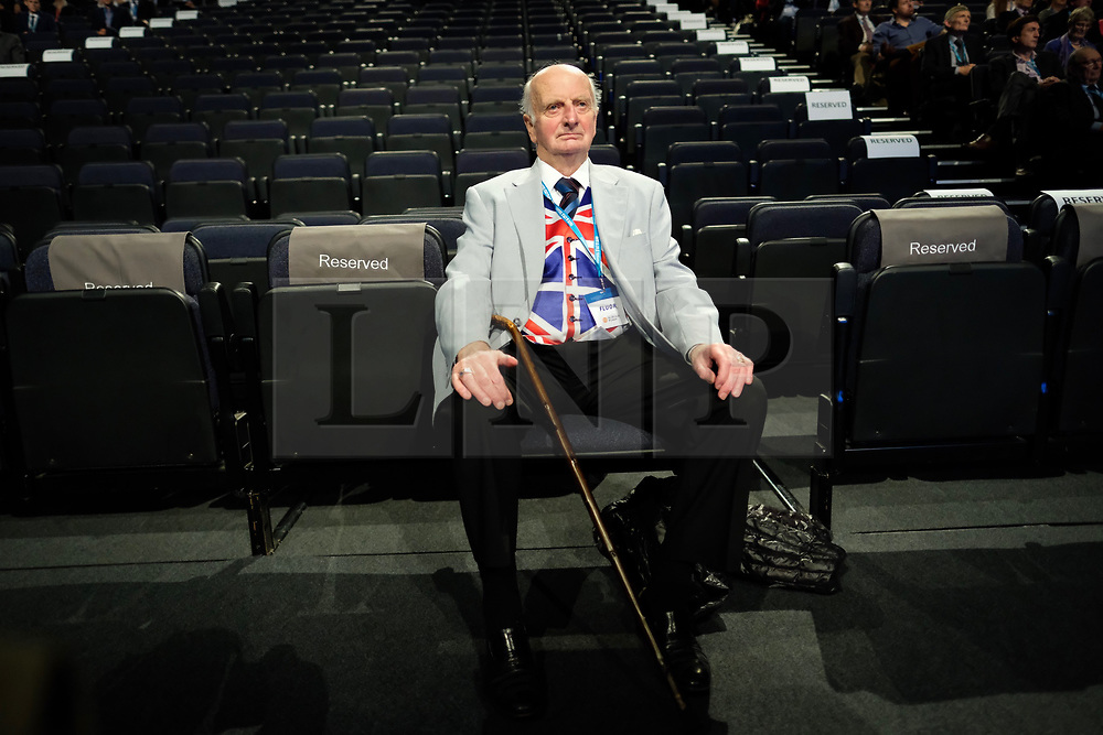 (c) Licensed to London News Pictures. <br /> 02/10/2017<br /> Manchester, UK<br /> <br /> A man wearing a Union Flag waistcoat sits waiting for a speech at the Conservative Party Conference held over four days at the Manchester Central Convention Complex.<br /> <br /> Photo Credit: Ian Forsyth/LNP