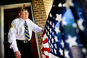 Korean War veteran Richard Pender stands outside his home in North Brunswick on May 14, 2015.