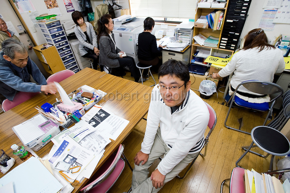 Toyoki Toshida, a suicide and credit counselor, sits in his office in Saitama, just north of Tokyo, Japan. Drowning in debt, Yoshida attempted to take his own life 7 years ago, but today tries to stop others in similar situations from committing suicide on 06 Nov. 2009...