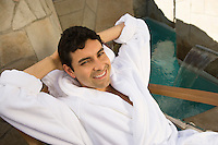 Portrait of man in bathrobe, relaxing outdoors