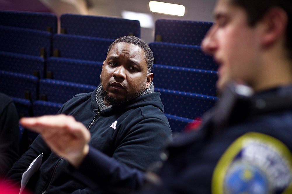 MILWAUKEE, WI – MARCH 28: Tory Lowe, left, listens to a harrowing story told by Milwaukee Police Department officer Ismar Kulenovic during a Zeidler Center Police and Resident discussion circle at Grace Fellowship Church on Monday, March 28, 2016.