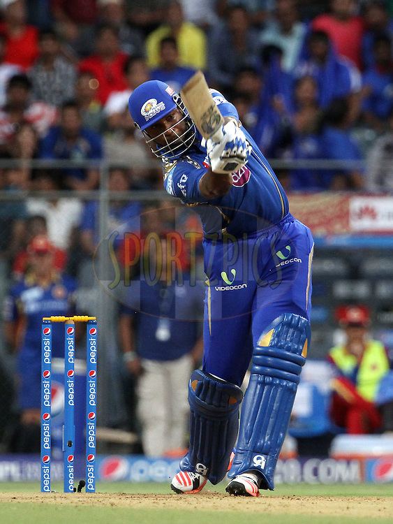 Mumbai Indians player Kieron Pollard plays a shot during match 46 of the Pepsi IPL 2015 (Indian Premier League) between The Mumbai Indians and The Royal Challengers Bangalore held at the Wankhede Stadium in Mumbai, India on the 10th May 2015.<br /> <br /> Photo by:  Vipin Pawar / SPORTZPICS / IPL