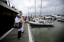 © Licensed to London News Pictures. 18/09/2016. Portsmouth, UK. The umpire waiting for this boat. Teams take part in the  Bramble Bank Cricket Match in the middle of The Solent strait on September 18, 2016. The annual cricket match between the Royal Southern Yacht Club and The Island Sailing Club, takes place on a sandbank which appears for 30 minutes at lowest tide. The game lasts until the tide returns. Photo credit: Ben Cawthra/LNP