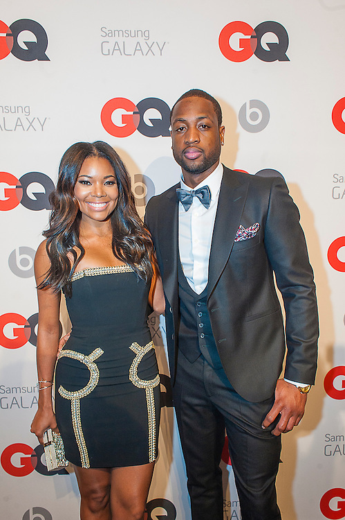 Dwyane Wade (Miami Heat) with Grabrielle Union posing at the GQ & Lebron James NBA All Star Style party sponsored by Samsung Galaxy on Saturday, February 15, 2014, at the Ogden Museum of Southern Art in New Orleans, Louisiana with live jam session from grammy Award-winning Artist The Roots. Photo Credit: Gustavo Escanelle / Retna Ltd.