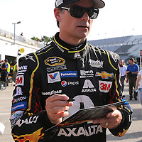 Sprint Cup Series driver Jeff Gordon (24) signs autographs during the 57th Annual NASCAR Coke Zero 400 practice session at Daytona International Speedway on Friday, July 3, 2015 in Daytona Beach, Florida.  (AP Photo/Alex Menendez)