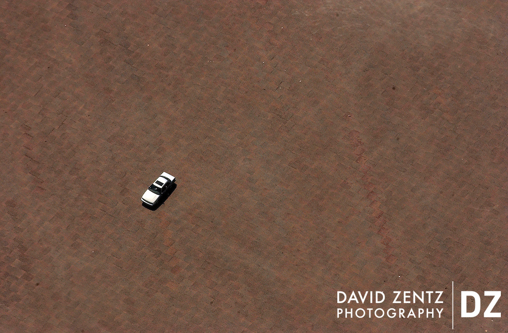 A lone car, seen from the Sanyo blimp, sits in a parking lot in West Chicago on a Sunday morning.