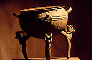 This cast copper cauldron with ram's head legs dated from the 5th to 3rd centuries B.C. it was found in 1912 in the Semirechye area.  It stands 58.5 centimeters high (23 inches).  It is 31.5 centimeters (12 inches) deep and 52 centimeters (20 inches)  in diameter.  Cauldrons such as this werer used to cook the meat of sacrificial animals, or at the start of seasonal events such as the spring festival of Nauriz.  Central State Museum, Almaty, Kazkhstan