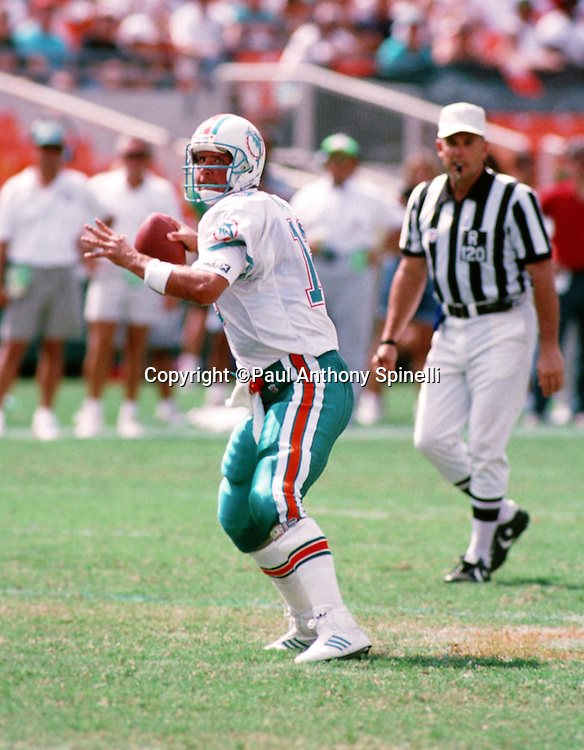 Miami Dolphins quarterback Dan Marino (13) throws a pass during the NFL football game against the Atlanta Falcons on Oct. 11, 1992 in Miami. The Dolphins won the game 21-17. (©Paul Anthony Spinelli)