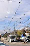 Electric Melbourne tram and power-lines on the outskirts of Melbourne, Australia