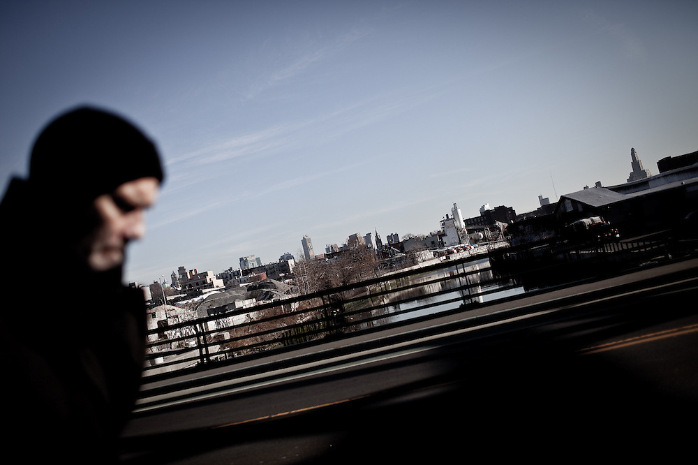 A man crosses the 9th Street Bridge over the Gowanus Canal, Brooklyn.