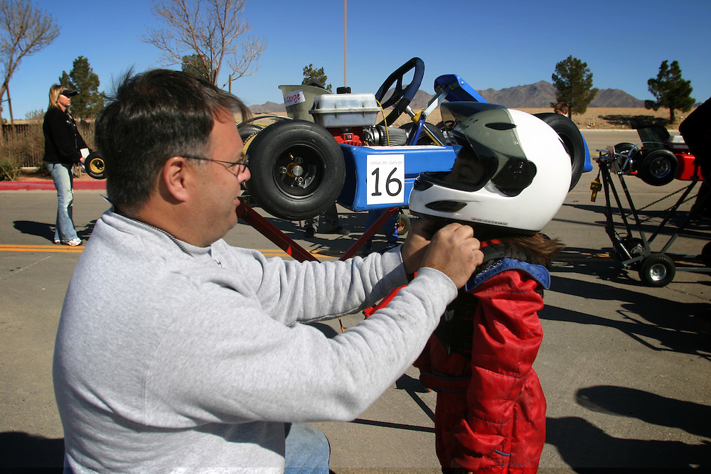 Kith  St. George taete the helmet to Chloe St. George 6 his daughter before the race in Primm Nevada  on Saturday march 3 .2007...