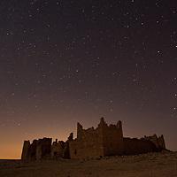 Ancient Roman built fortress Qasr Bashir under stars
