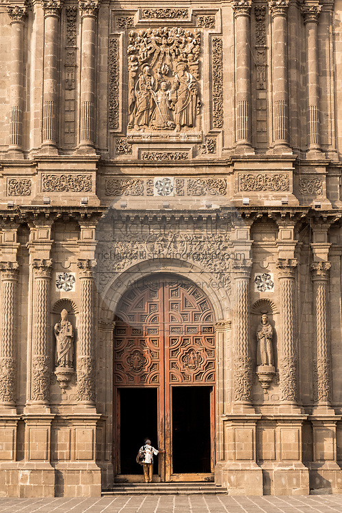 Facade and cantera stone portal of the Church of Santo Domingo in Santo Domingo plaza in the historic center of Mexico City, Mexico.