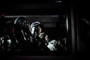 Dopo lo sbarco nel porto di Lampedusa i migranti vengono trasferiti al centro di prima di accoglienza. Lampedusa 19 maggio 2015.  Christian Mantuano / OneShot <br /> <br /> Migrants are taken to the reception center after disembarking in Lampedusa harbor on May 19, 2015. Christian Mantuano / OneShot