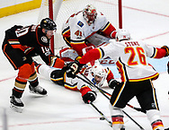 Calgary Flames defenseman Mark Giordano (C) makes a save shot by Anaheim Ducks forward Corey Perry (L) during a 2017-2018 NHL hockey game in Anaheim, California, the United States, on Oct. 9, 2017.  Calgary Flames won 2-0. (Xinhua/Zhao Hanrong)