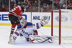 Mar 25, 2010; Newark, NJ, USA; New Jersey Devils right wing Jamie Langenbrunner (15) shoots the puck wide of New York Rangers goalie Henrik Lundqvist (30) during the first period at the Prudential Center.