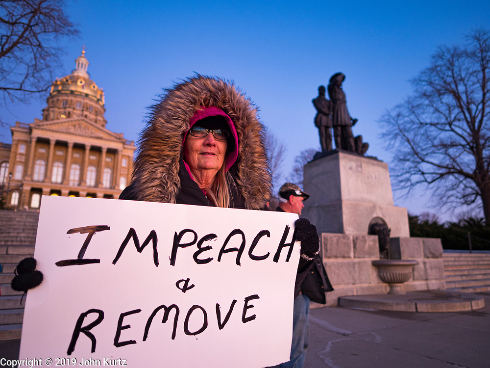 17 DECEMBER 2019 - DES MOINES, IOWA: SANDI MURRAY, from Des Moines, stands on the steps of the state capitol and calls for the impeachment of President Donald Trump. About 300 people came to the Iowa State Capitol in Des Moines in near freezing weather Tuesday evening to call for Trump's impeachment. The rally, and others like it around the US, come on the eve of an impeachment vote in the US House of Representatives.     PHOTO BY JACK KURTZ