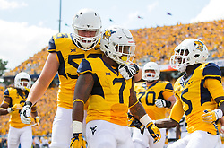 Sep 3, 2016; Morgantown, WV, USA; West Virginia Mountaineers running back Rushel Shell (7) celebrates with West Virginia Mountaineers offensive lineman Colton McKivitz (53) and West Virginia Mountaineers wide receiver Jovon Durante (5) after scoring a touchdown during the first quarter against the Missouri Tigers at Milan Puskar Stadium. Mandatory Credit: Ben Queen-USA TODAY Sports