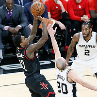 01 May 2017: Houston Rockets guard Lou Williams (12) takes a jump shot over San Antonio Spurs guard Manu Ginobili (20) during the Houston Rockets 126-99 victory over the San Antonio Spurs, in game 1 of the Western Conference Semi Finals, at the AT&T Center, San Antonio, Texas, USA.