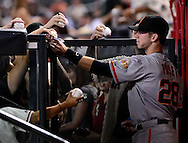 Sep. 14, 2012; Phoenix, AZ, USA; San Francisco Giants catcher Buster Posey (28) signs autographs for fans before the game against the Arizona Diamondbacks at Chase Field.  Mandatory Credit: Jennifer Stewart-US PRESSWIRE