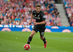 STOKE-ON-TRENT, ENGLAND - Sunday, August 9, 2015: Liverpool's Adam Lallana in action against Stoke City during the Premier League match at the Britannia Stadium. (Pic by David Rawcliffe/Propaganda)