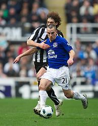 NEWCASTLE, ENGLAND - Saturday, March 5, 2011: Everton's Leon Osman and Newcastle United's Fabricio Coloccinni during the Premiership match at St. James' Park. (Photo by David Rawcliffe/Propaganda)