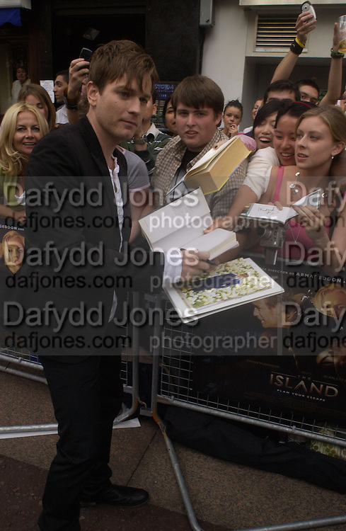 """Ewan McGregor<br /> signing autographs while  arriving at the UK Premiere of """"The Island"""" at the Odeon Leicester Square, London. 7 August 2005. , ONE TIME USE ONLY - DO NOT ARCHIVE  © Copyright Photograph by Dafydd Jones 66 Stockwell Park Rd. London SW9 0DA Tel 020 7733 0108 www.dafjones.com"""