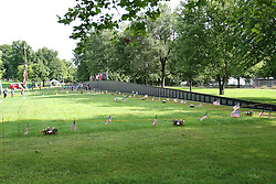 26 August 2016:  The Wall - a mobile replica of the Vietnam Memorial Wall - was displayed in Evergreen Memorial Cemetary in Bloomington Illinois.  There are several traveling tributes, this is one is the American Veterans Traveling Tribute (AVTT) Vietnam Wall and is an 80% of full size of the memorial in Washington DC <br /> <br /> Several tents full of memorabilia and artifacts were also on display.