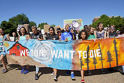 May 24, 2019 - Washingon, District of Columbia, U.S - Students march from the White House to the U.S. Supreme Court to support the Green New Deal and pass the Climate Change Education Act on May 24, 2019 in Washington, D.C. Students from around the world are marching for climate change awareness today. (Credit Image: © Leigh VogelZUMA Wire)