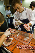 A cook prepares bone marrow at El Bulli restaurant near Rosas on the Costa Brava in Northern Spain.
