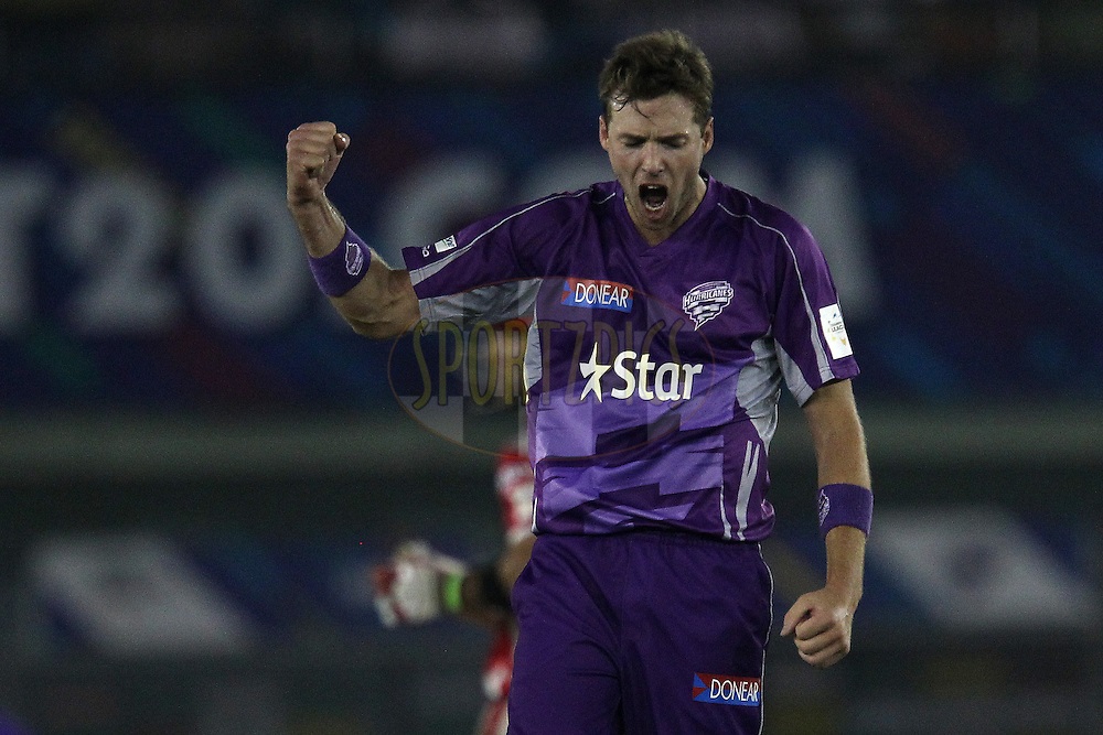 Ben LAUGHLIN of the Hobart Hurricanes celebrates the wicket of Manan VOHRA of the Kings XI Punjab  during match 2 of the Oppo Champions League Twenty20 between the Kings XI Punjab and the Hobart Hurricanes held at the Punjab Cricket Association Stadium, Mohali, India on the 18th September 2014<br /> <br /> Photo by:  Ron Gaunt / Sportzpics/ CLT20<br /> <br /> <br /> Image use is subject to the terms and conditions as laid out by the BCCI/ CLT20.  The terms and conditions can be downloaded here:<br /> <br /> http://sportzpics.photoshelter.com/gallery/CLT20-Image-Terms-and-Conditions-2014/G0000IfNJn535VPU/C0000QhhKadWcjYs
