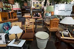 Stalls at busy weekend flea market in Boxhagener Platz in Friedrichshain , Berlin, Germany