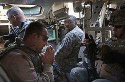 Translator Munir Abdullah Makh prays inside the Stryker armored vehicle before heading out on patrol with members of the 1st Infantry, 17th Regiment, in western Mosul, Iraq, Dec. 11, 2005. This is part of an effort to provide security in preparation for Iraq's first post-Saddam parliamentary elections. The western sector is home to Mosul's primarily Sunni population, which has been resistant to the American presence in Iraq.
