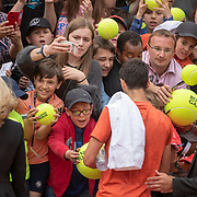PARIS, FRANCE May 25. Novak Djokovic of Serbia signing autographs after training on Court Suzanne Lenglen in preparation for the 2019 French Open Tennis Tournament at Roland Garros on May 25th 2019 in Paris, France. (Photo by Tim Clayton/Corbis via Getty Images)