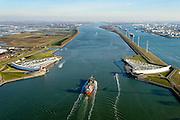 Nederland, Zuid-Holland, Rotterdam, 18-02-2015; Maeslantkering in de Nieuwe Waterweg, gezien vanaf Hoek van Holland. Rechts het Calandkanaal en de Maasvlakte, Rotterdam aan de horizon. De stormvloedkering bestaat uit twee deuren die klaar liggen in een dok en welke sluiten bij een waterstand van 3 meter of meer boven NAP. De kering, laatst voltooide onderdeel van Deltawerken, beschermt Rotterdam en achterland bij extreme waterstanden.<br /> The new storm surge barrier (Maeslantkering) in the Nieuwe Waterweg (New Waterway, the entrance to the port of Rotterdam), Rotterdam at the horizon. In case of storm floods, the two enormous doors will close of the waterway protecting Rotterdam and its hinterland.<br /> luchtfoto (toeslag op standard tarieven);<br /> aerial photo (additional fee required);<br /> copyright foto/photo Siebe Swart