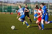 Brighton's Kirsty Barton grits her teeth as Amy Taylor  goes shoulder to shoulder with Charlton's Kit Graham during the FA Women's Premier League Cup quarter-final match between Brighton Ladies and Charlton Athletic WFC at The American Express Elite Football Performance Centre, Lancing, United Kingdom on 1 March 2015. Photo by Geoff Penn.