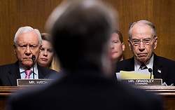 Sep 27, 2018 - Washington, District of Columbia, U.S. -  Sen. ORRIN HATCH, R-Utah, left, and Sen. CHUCK GRASSLEY, R-Iowa, listen as Judge BRETT KAVANAUGH testifies during the Senate Judiciary Committee hearing on his nomination be an associate justice of the Supreme Court of the United States, focusing on allegations of sexual assault by Kavanaugh against C. Blasey Ford in the early 1980s.  (Credit Image: © Tom Williams/Pool via ZUMA Wire)